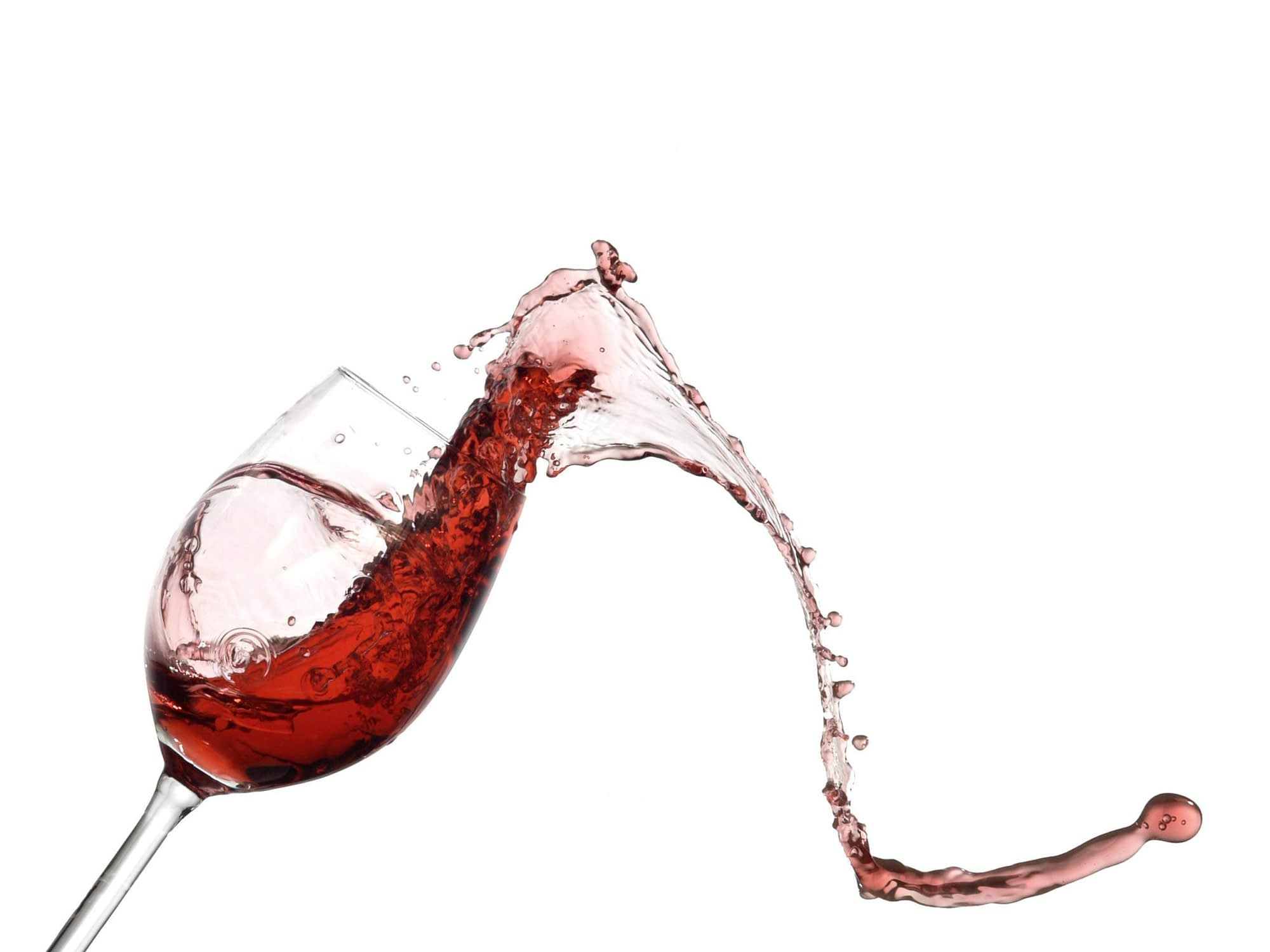 red wine spilling on a carpet